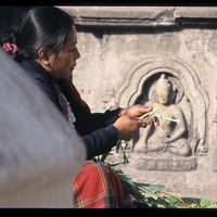 Nepal 2002 - There is a thriving community around Swayambunath, the Monkey Temple who trade with visitors. The temple os on the outskirts of Kathmandu. At the bottom of the approach stair is the