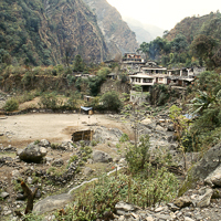 Nepal 2002 - The trail runs through Tatopani and follows the river until you reach the massive glacial terminal morraine with effectively blocks the river, resulting in a heavily braded river above the village of Nanopani, literlly