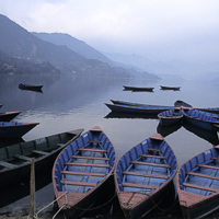 Nepal 2002 - In the early morning light, boats wait to be hired on Dhal Lake near the town of Pokhara in western Nepal. Lakeside, as it is known, is a popular resting place for travelers after treks in the mountains to the north.